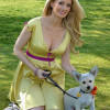 Holly Madison Shows off her Baby Bump in Yellow and Fushcia Frock Thumbnail