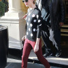 Taylor Swift Teamed her Polka Dot Jumper with Rough Trousers and Sunglasses Thumbnail